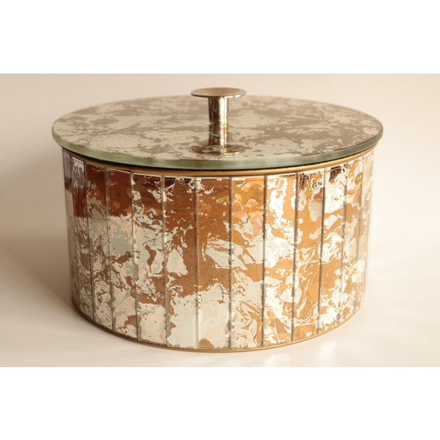 Mid-century box clad with gold, silver, and cream marbled mirror. From an American company renowned for making Disco...