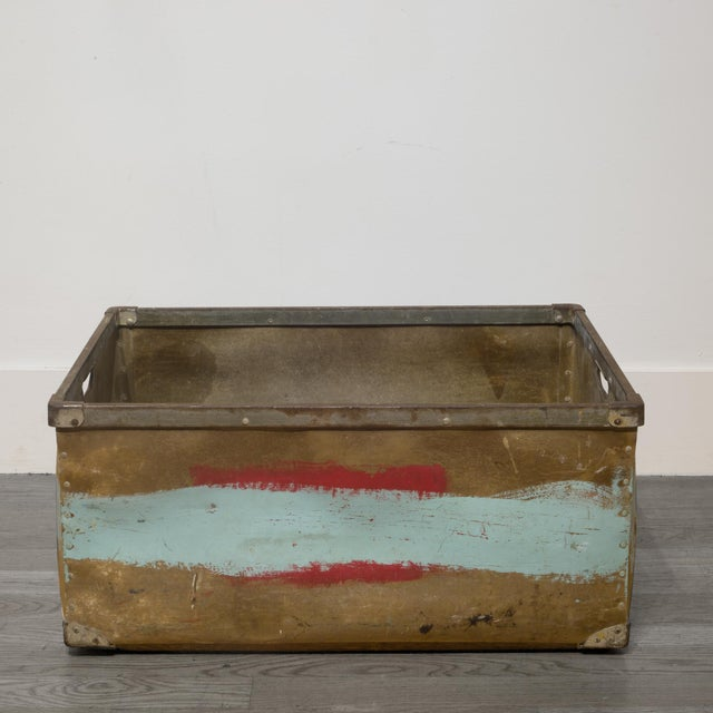 ABOUT This is a large factory bin with steel bands, handles and wooden slats on the bottom. The body appears to be...
