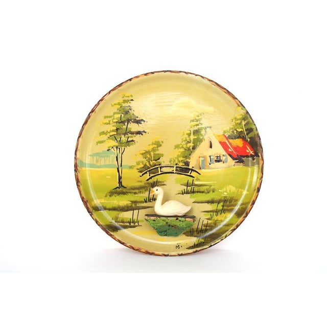 This is the coolest vintage wood souvenir plate from Holland. A white plastic goose anchored to a little ledge floats...