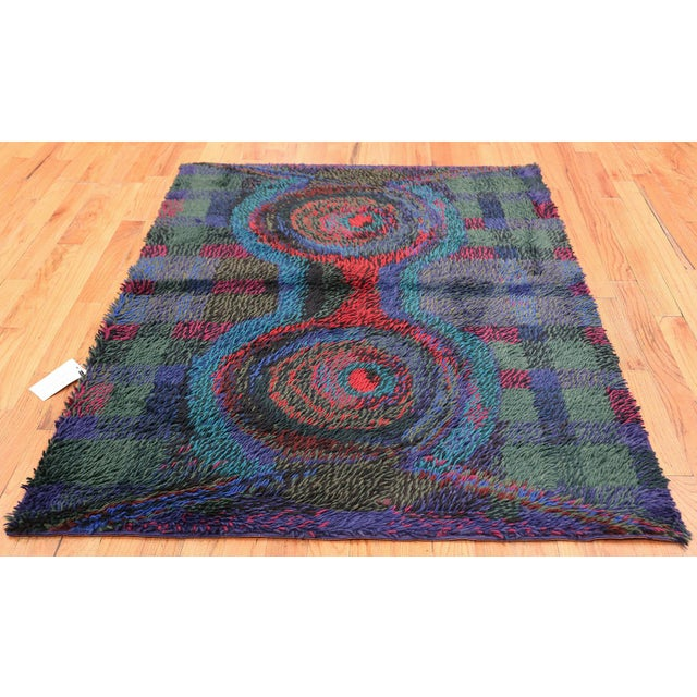 Vintage Scandinavian Rya rug by Ritva Puotila. Here is a highly unique and intriguing vintage carpet - a vintage Rya rug...