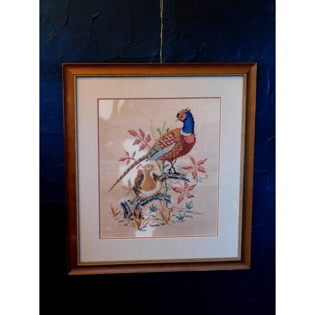 This sweet hand done needlepoint art depicts a Pheasant mama bird with her nest on a linen fabric. Adds a warm cottage...