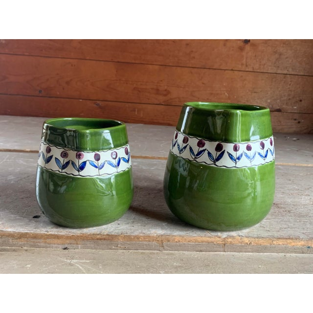 Offering a charming pair of Italian pitchers, crafted of pottery. Ideal to plant in or just display. Made in Italy. Circa...