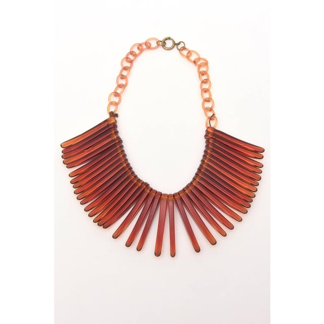 This very in vogue collar /choker Vintage resin bib necklace looks like fringe. It is tortoise like in color with resin...