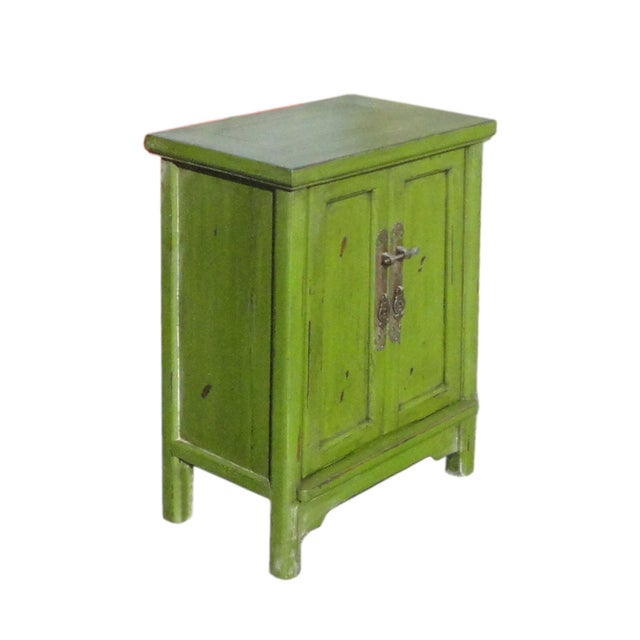 This is an oriental style end table nightstand in minor A shape design and painted with rustic light grass green surface...