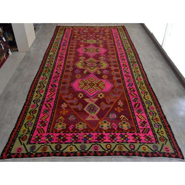 Made of wool on cotton using natural dyes, this vibrant Anatolia Turkis Kilim is in nearly perfect condition with only...