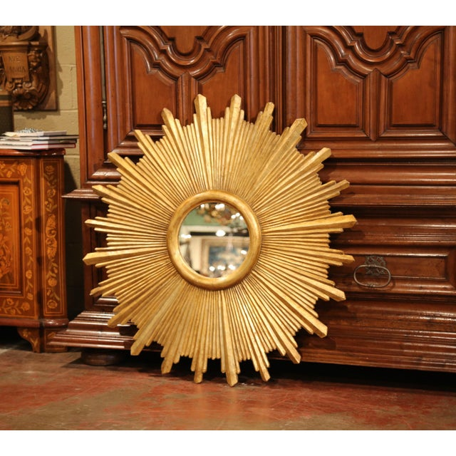 This unique pair of large gilt sun mirrors was crafted in Italy, circa 2010. Each piece features hand carved sun rays...