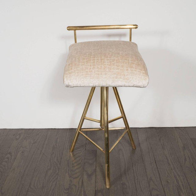 This stunning Mid-Century Modern stool features a tripod form consisting of three cylindrical brushed brass legs connected...