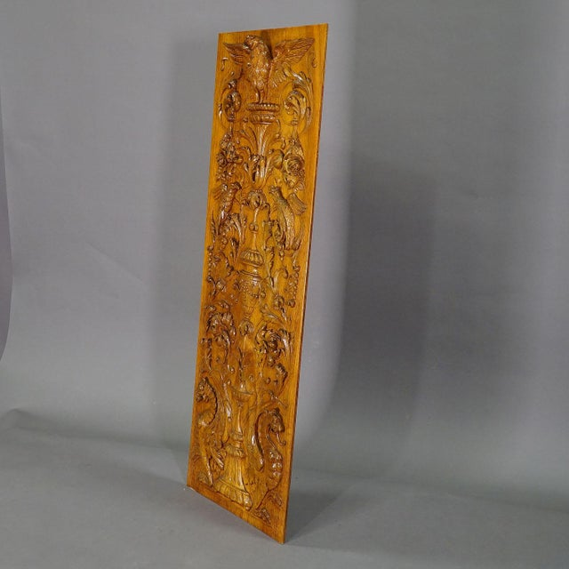 a large handcarved wooden panel with several carvings like eagle, gargoiles and empire style decorations. manufactured in...