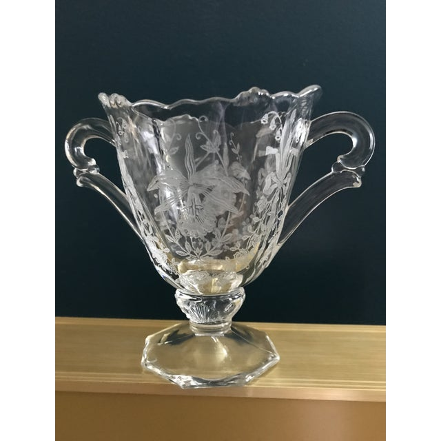 This sugar bowl and creamer are exquisite! They are crystal and have been etched with glorious flowers, including Lily of...