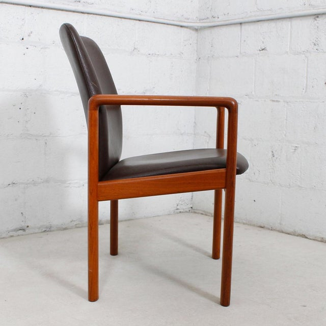 A thoroughly modern design combines with classic materials in this sophisticated Danish Modern arm chair, circa 1970. In...