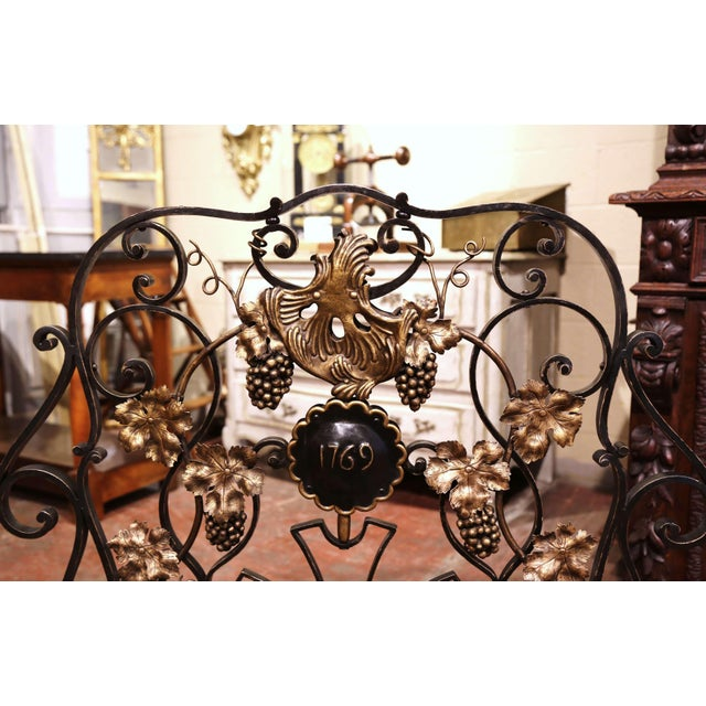 Decorate a fireplace hearth with this elegant freestanding antique iron screen. Forged in France circa 1950, the...