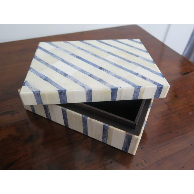 Beautiful handmade and handcrafted decorative and functional all natural bone inlay box. Great for any coffee table or...