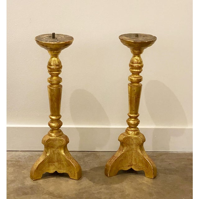 """Pair 1880's Italian gilt wood candlesticks that are gold with a red rub through. 9"""" Across x 27"""" High"""
