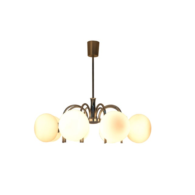 Luxe spider sputnik chandelier featuring a cascading design with (8) opal glass globes a beautiful streamline chrome frame...