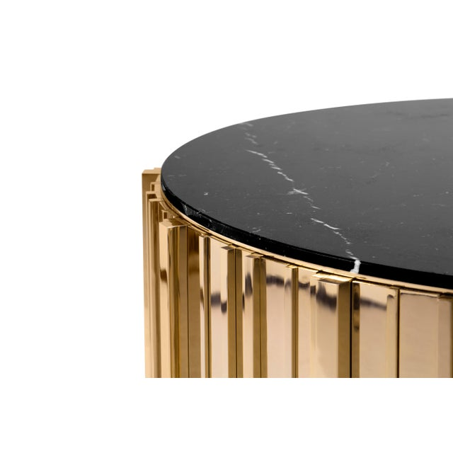 This center table has an extravagant shape of refinement and style. It is carefully made in brass and nero marquina...