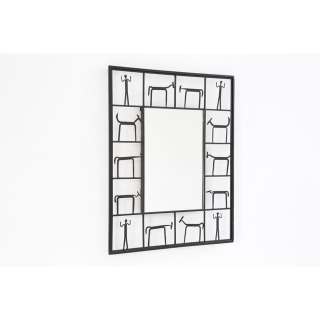 "decorative mirror by Frederick Weinberg USA, c 1950s iron + mirrored glass 30 ½"" h x 24 ½"" w x 2"" d"