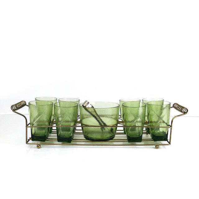 A set of 8 green textured square bottom glasses with a matching ice bucket in a gold tone brass caddy. Perfect to sit atop...