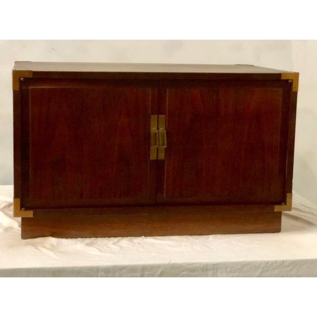 1970s campaign style trunk/ coffee table with original brass hardware. No maker's mark. It is in very good condition.