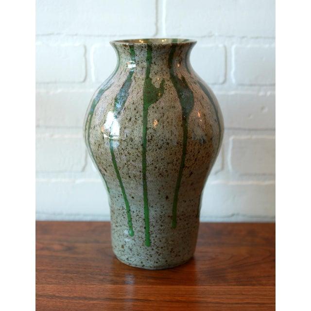 "Studio Pottery ceramic stoneware vessel with a vertically striated gray and green glaze. Signed ""Chiari"""