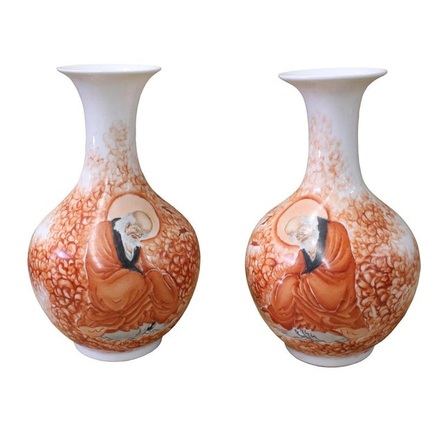 This is a pair of handmade Chinese accent decorative porcelain vases with white base color. The precise detail drawing of...