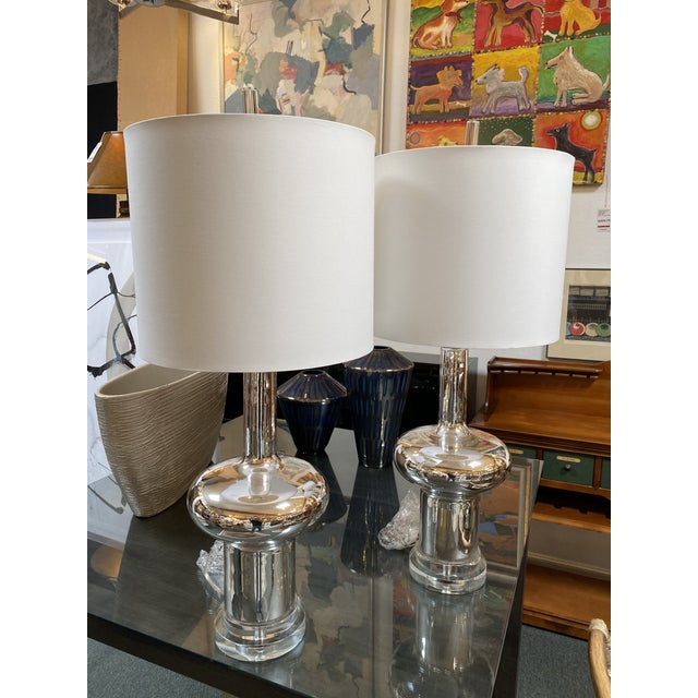 Design Plus Gallery presents a NEW Pair of Cyan Design Moonraker Nickel Table Lamps. Glass gourd form is finished with a...