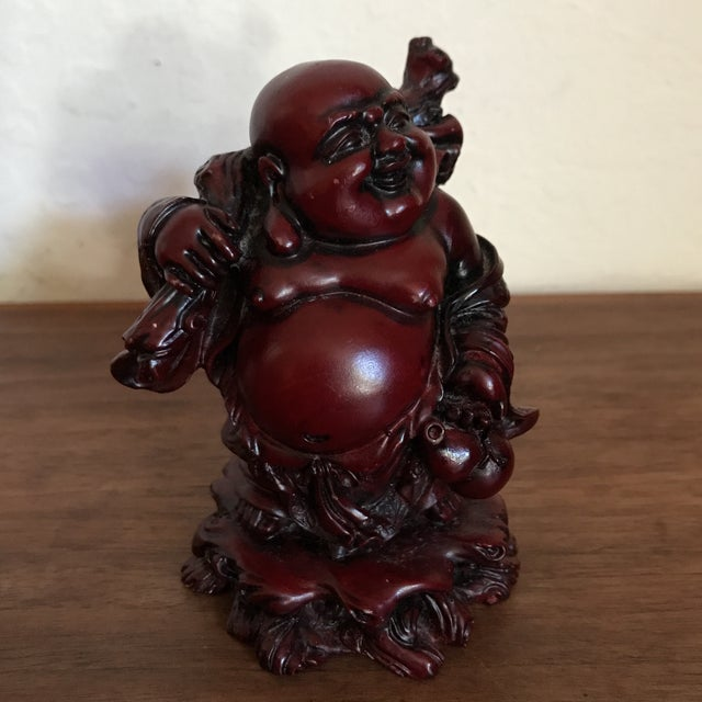 Cool small statue of a smiling traveling Buddha. The statue is in great shape with barely any signs of age and wear. Very...