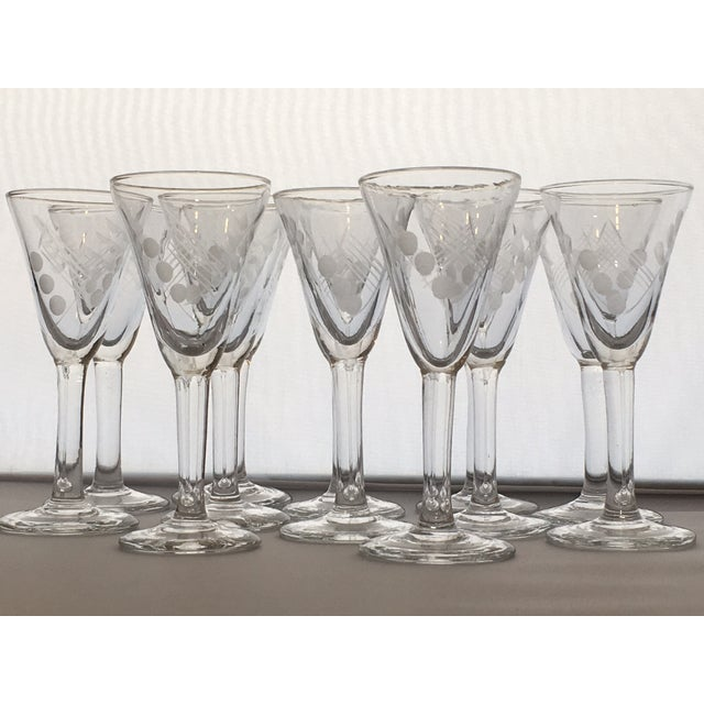 "Unique vintage barware set of 12 stemmed shot glasses. Each measures 4""T x 1.5""W and feature an etched leaf spray, dot and..."