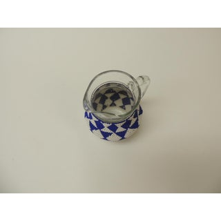 Small Vintage Glass Milk Jug With Handcrafted Artisanal Woven Beaded Cover Preview