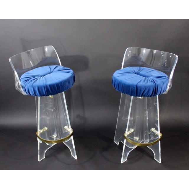 For your consideration is an absolutely fabulous pair of lucite and brass, swivel bar stools, with a deep, blue velvet...