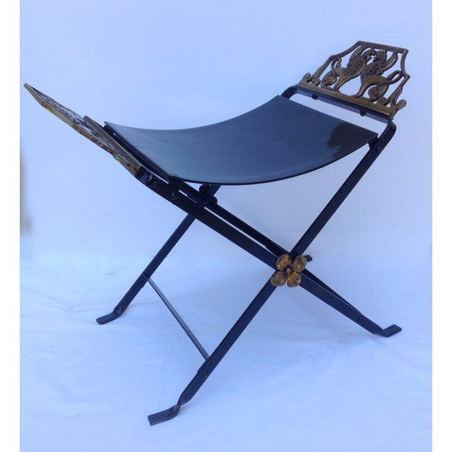 A vintage, Early American, 1920's, Neoclassical, hand forged, wrought iron, x-frame bench with opposing ended Gryphons....