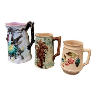 Set of Three 19th Century French Barbotine Ceramic Pitchers For Sale