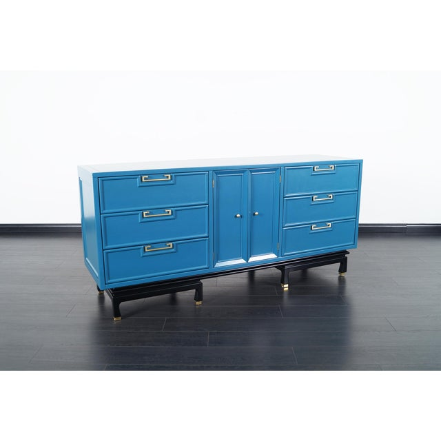 Vintage lacquered dresser by American of Martinsville. Newly refinished in a laguna blue finish with a black base. The...