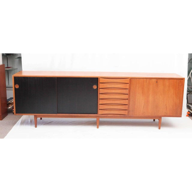 Arne Vodder sideboard designed in 1959 and produced by Sibast Mobler. The two doors are reversible so the other side of...