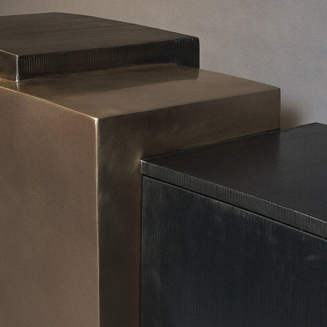 Gary Magakis' blackened steel, mirror-polished bronze, and textured bronze console reflects the sculptor's distinct...