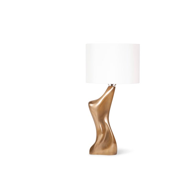 """Helen table lamp is a dynamic shape table lamp with gold finish. Dimension of the table lamp is 8"""" L x 6"""" W x 19"""" H. Shade..."""