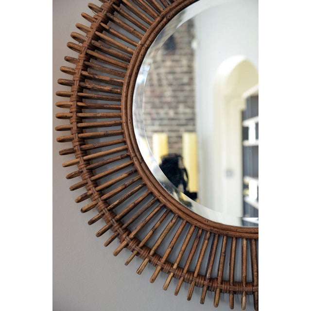 The 'Oculus' round rattan mirror with inserted flat mirror.