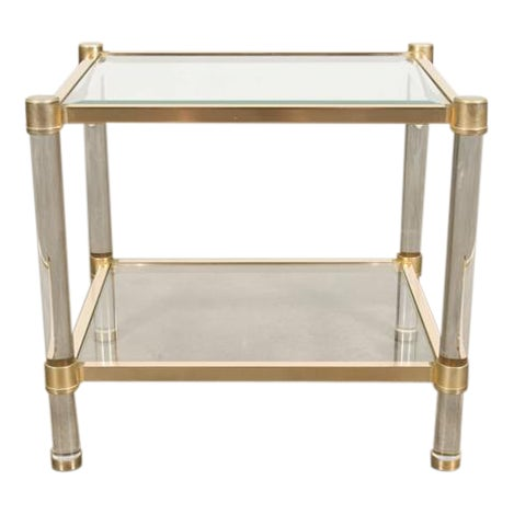 French two-tier Lucite and brass rectangular side table with beveled glass top and lower glass shelf. circa 1970s....
