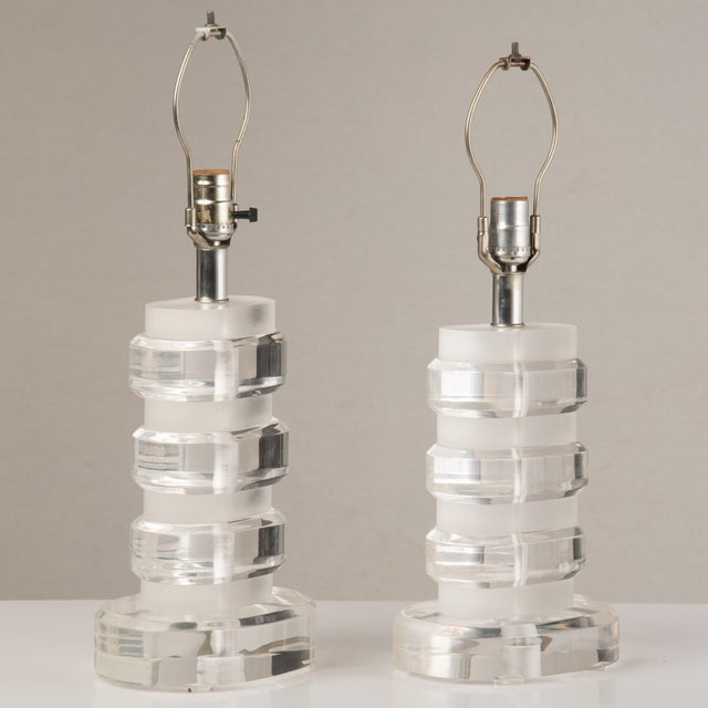 Being handcast, these two lamps are sculptural and have variations in the thicknesses of the bases and the spacers....