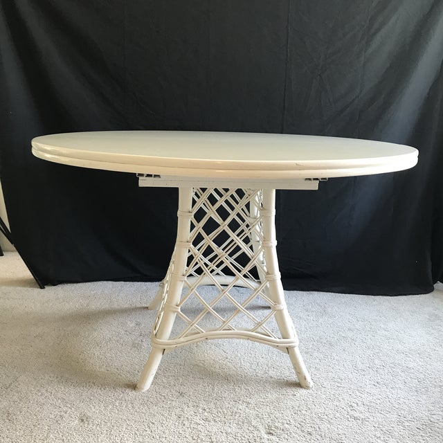Fabulous vintage Ficks Reed dining table with wicker Also included is one 17.75 inch leaf. The pedastal has the classic...