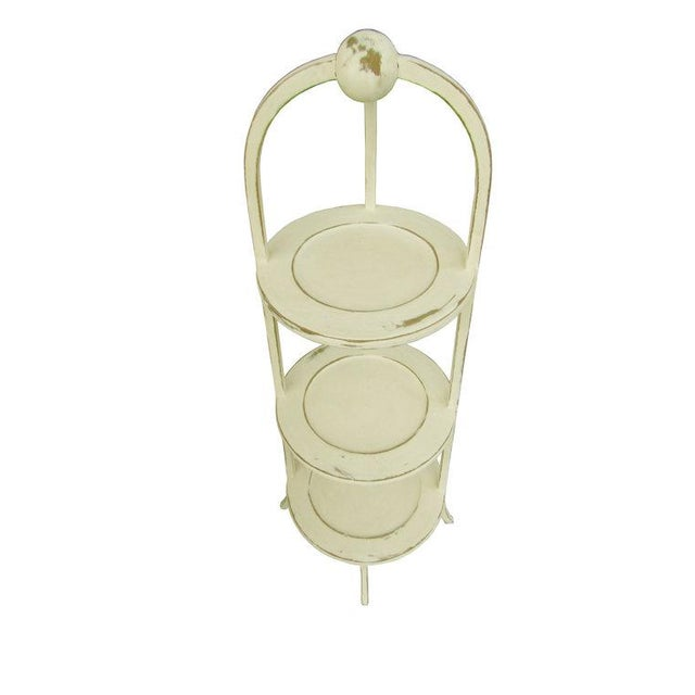 Originating in England, this charming three-tier serving stand is perfect for plates or tea service. It has been updated...
