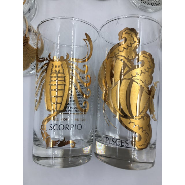 A stunning set of 12 Zodiac cocktail glasses by Anchor Hocking from the 1960s. Each glass is adorned with one zodiac sign...