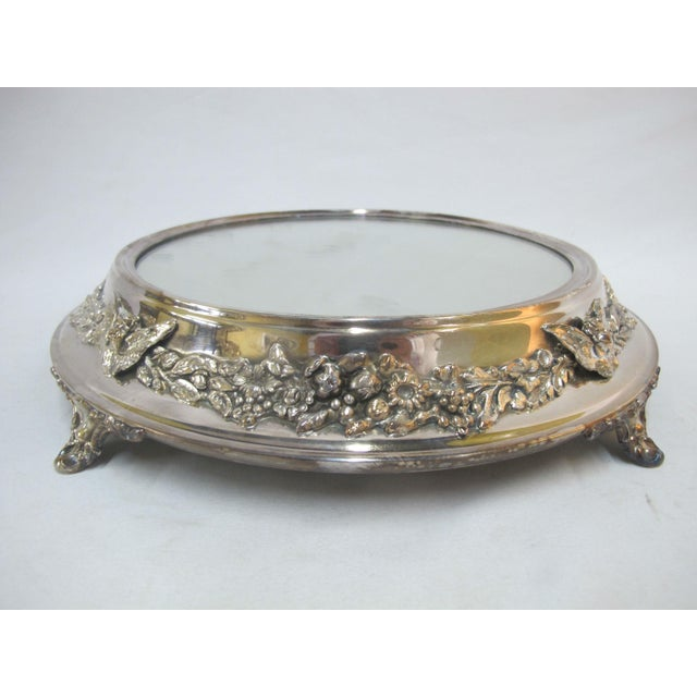 """Elaborate antique vanity tray with mirror. Round footed tray has ornate cherub and flower design. Measures 12"""" x 2 1/2""""..."""