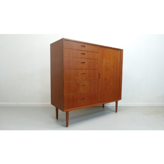 Beautiful mid century Danish modern large teak wardrobe gentleman's chest tambour door dresser by Falster of Denmark. This...