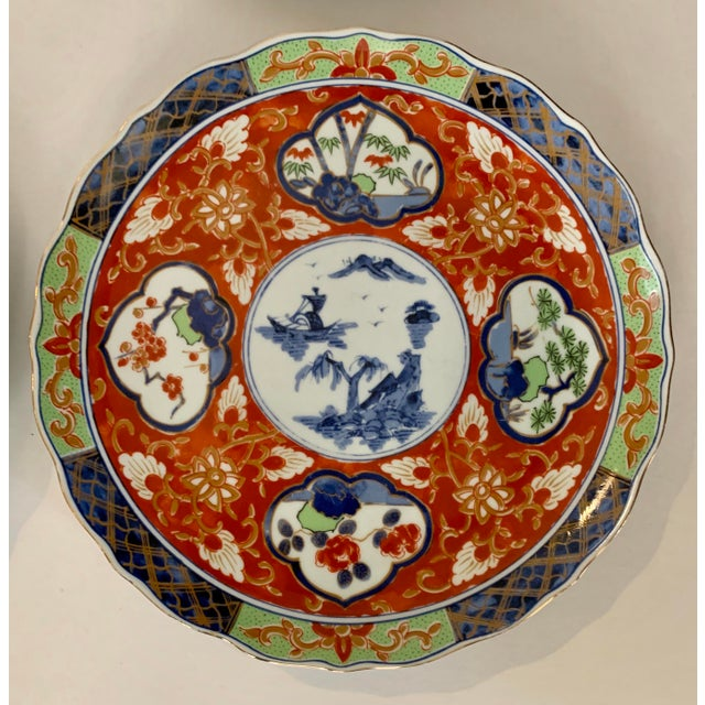 A fine set of Japanese Imari porcelain. 5 dinner and 5 salad plates, Decorated in typical traditional Imari colors of...