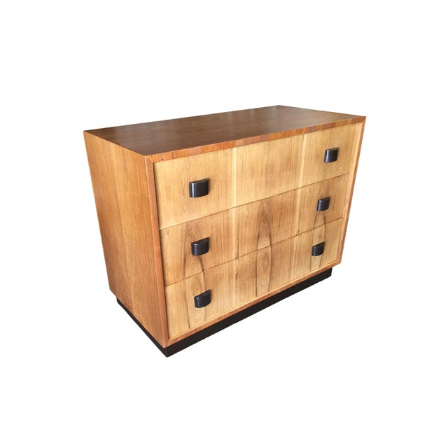 George Nelson inspired lowboy dresser pair featuring two dressers each with 3 drawers each. Each dresser has a walnut body...