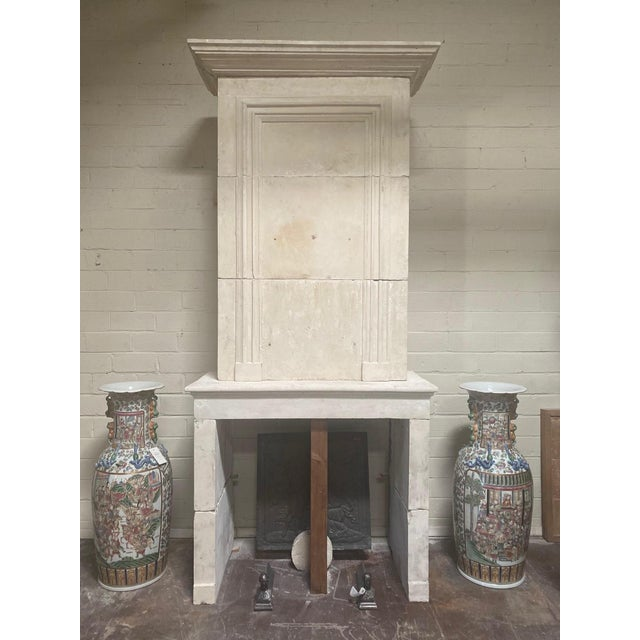 """This bold limestone fireplace features a tall trumeau. The piece originates from France, circa 1820. Measurements: 115"""" H..."""
