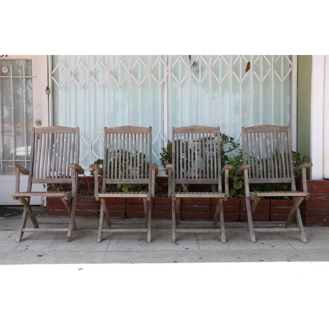 Vintage condition outdoor teak folding patio chairs in well kept condition. In the sides they have a small hook that locks...