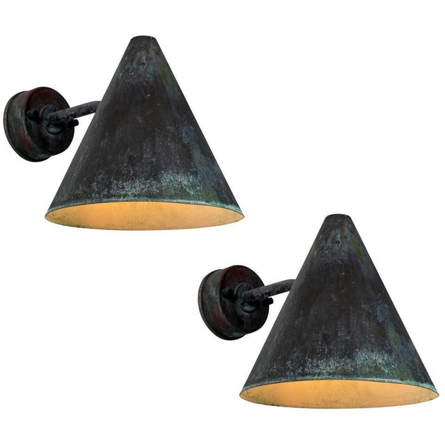 1950s Hans-Agne Jakobsson 'Tratten' outdoor sconces. Produced by AB in Markaryd, Sweden and executed in richly weathered...