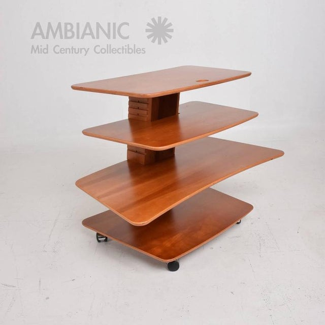 For your consideration a mid-century Danish modern adjustable stand/table with wheels. Stamped underneath with makers...