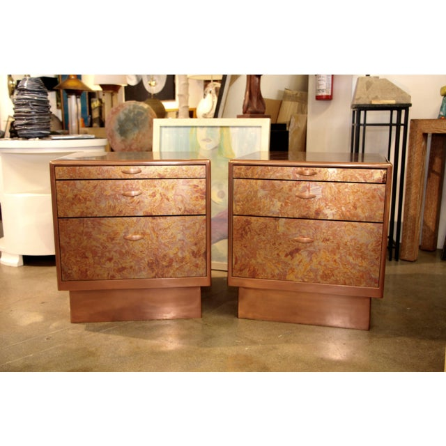 A beautiful pair of nightstands or end tables with patinated copper sheets on top front and side. The bases have been...